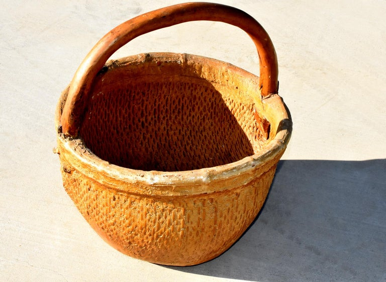 20th Century Antique Chinese Country Willow Basket, with Tree Branch Handle and Iron Brackets For Sale