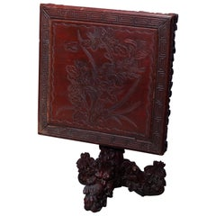 Antique Chinese Deeply Foliate Carved Hardwood Tilt-Top Table, 19th Century