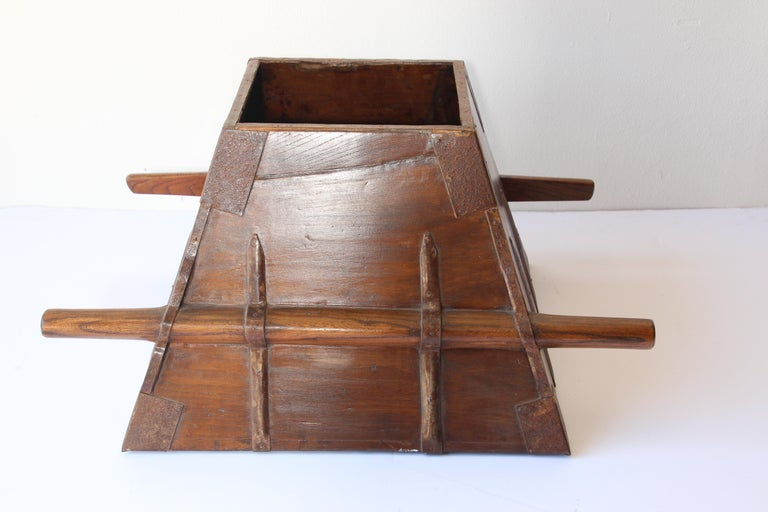 Large antique Chinese 19th century Elmwood rice measure with iron decoration and handles. A rustic antique handcrafted Chinese rice measure storage basket with beautiful patina and original metal hardware, circa 1880. from Zhejiang, China. Great