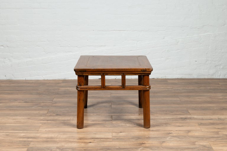 Qing Antique Chinese Elmwood Table with Pierced Apron and Pillar-Shaped Struts Motifs For Sale