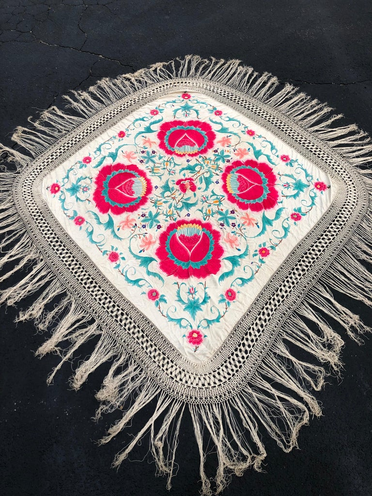 Antique Chinese embroidered silk piano shawl. The style is Manton de Manila, floral crepe de chine. This silk beauty boasts large floral bouquets in red with butterflies. Most likely dates from the 1920s-1930s. It was owned by the famous Broadway