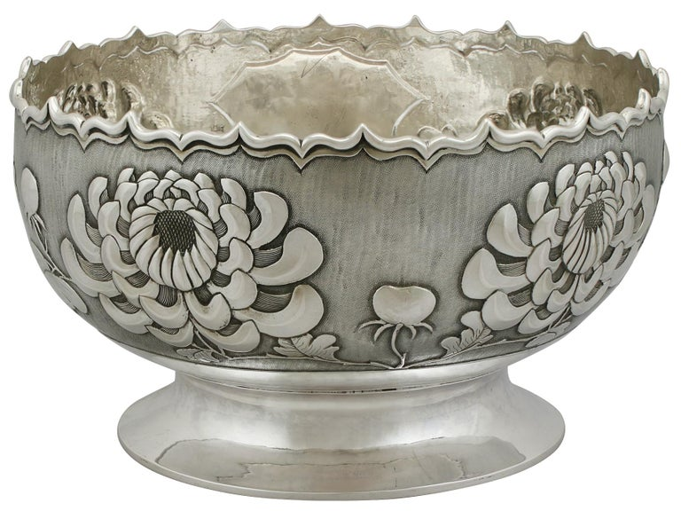 An exceptional, fine and impressive antique Chinese export silver bowl; an addition to our Asian silverware collection.  This exceptional Chinese export silver bowl has a plain circular form onto a plain circular swept, spreading foot.  The body of