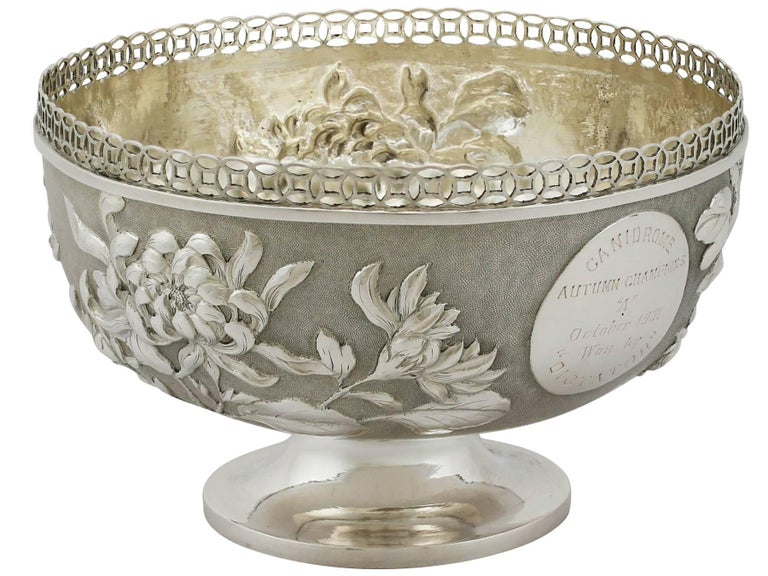 A fine and impressive antique Chinese export silver bowl; an addition to our Chinese/Asian silverware collection.  This exceptional Chinese export silver bowl has a plain circular form onto a plain circular spreading foot.  The body of this