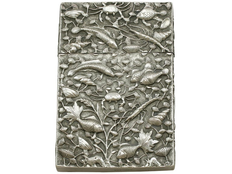 An exceptional, fine and impressive antique Chinese export silver card case; part of our diverse Asian silverware collection.  This exceptional antique Chinese export silver (CES) card case has a plain rectangular rounded form.  The anterior