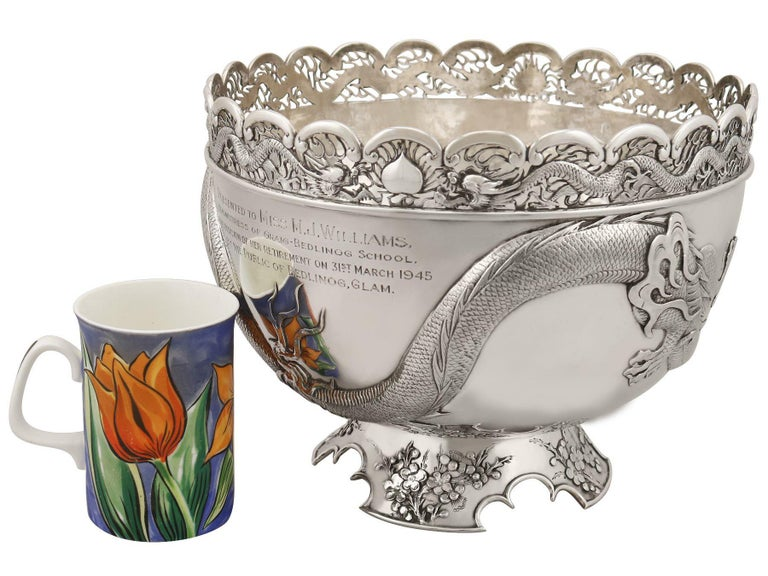 A magnificent, fine and impressive antique Chinese Export Silver dragon bowl; an addition to our Chinese/Asian silverware collection.  This impressive Chinese Export Silver (CES) bowl has a circular rounded form onto a circular spreading foot.  The