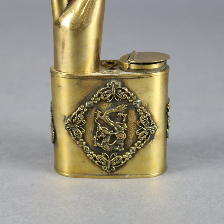 Antique Chinese handcrafted brass opium pipe features applied reserve with foliate and butterfly border with central dragon, applied dragon on stem and coral bead on chain, circa 1910  ***DELIVERY NOTICE – Due to COVID-19 we are employing NO-CONTACT