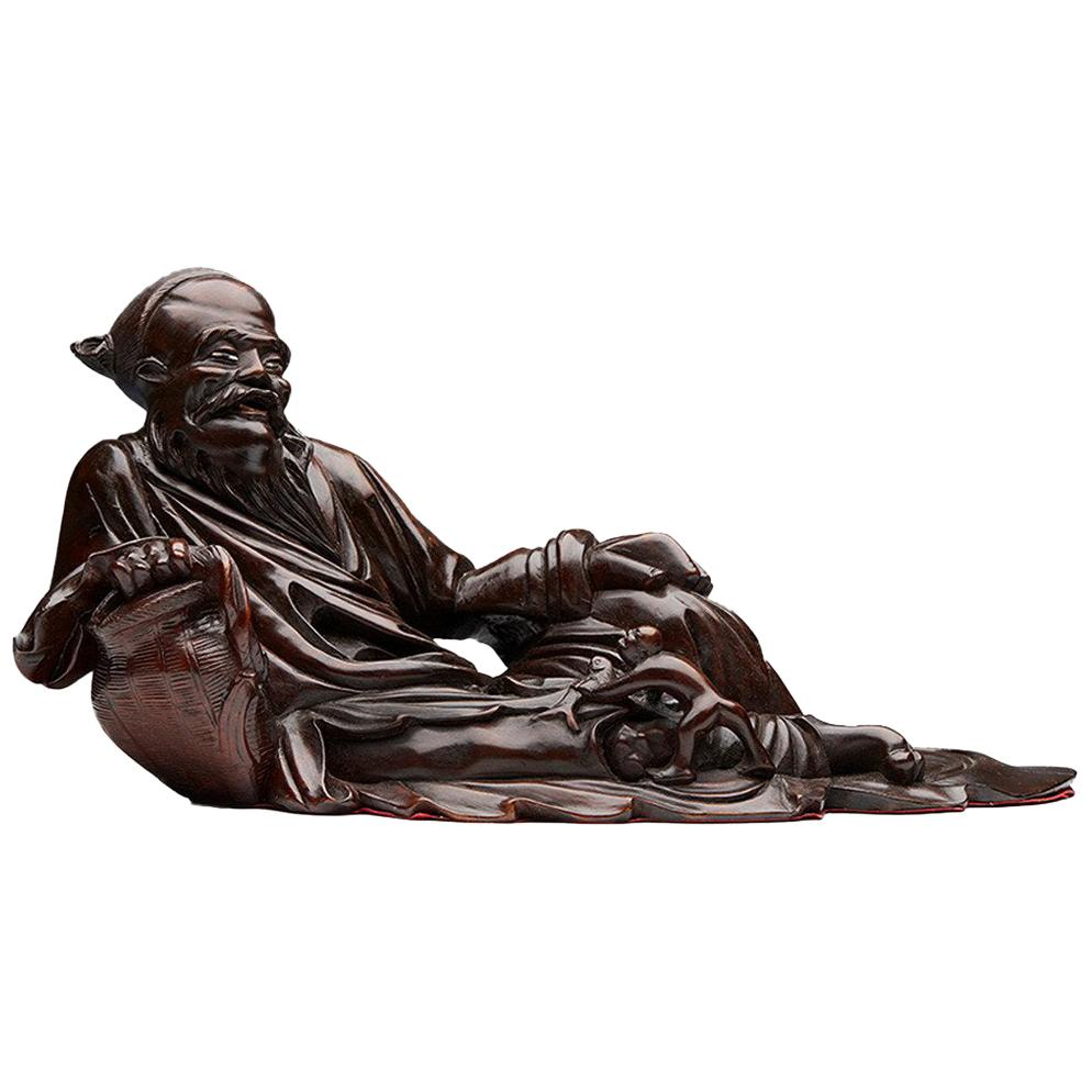 Antique Chinese Hardwood Reclining Immortal Figure, Early 20th Century