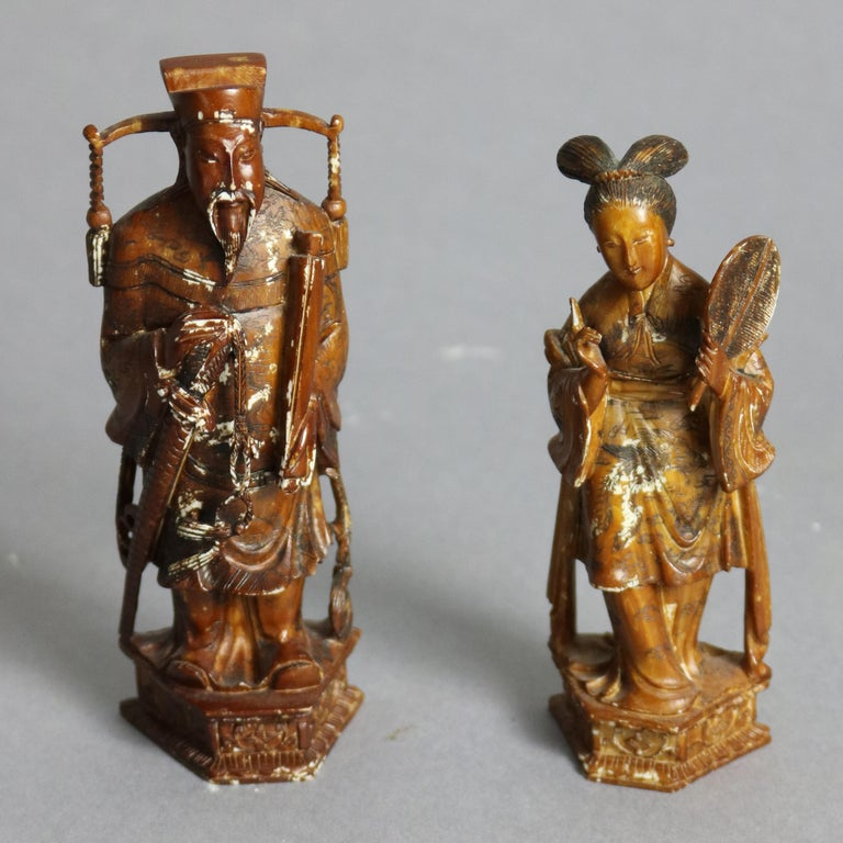 An antique Chinese chess set offers highly detailed hand carved figures, each an individual sculpture, with protective case having individual cradles for each piece and chess board exterior, circa 1920  ***DELIVERY NOTICE – Due to COVID-19 we are