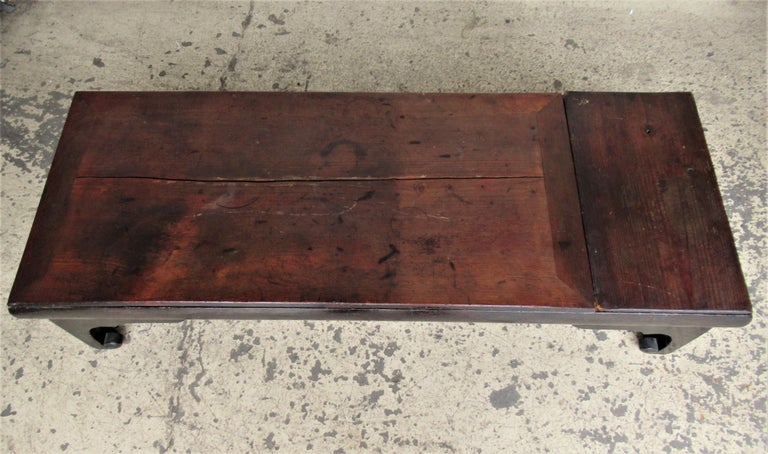 Antique 19th century Chinese low table / coffee table with an incredibly beautiful archaic form and nicely aged original color and great old surface. Two board top is removable / the base with divided interior compartments. Look at all pictures and