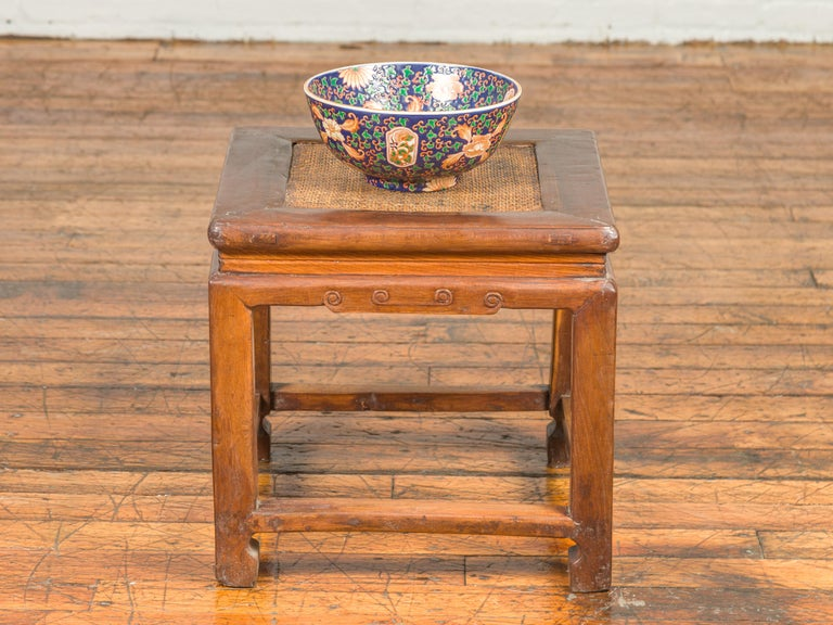 Antique Chinese Ming Style Waisted Stool with Horsehoof Legs and Rattan Inset In Good Condition For Sale In Yonkers, NY