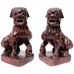 Antique Chinese Pair of Red Lacquered Wooden Fu Dogs, Qing Dynasty