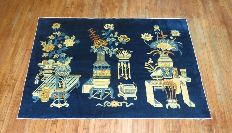 A Chinese pictographic rug in predominant shades blue. The wool is very soft and all the colors are natural. Soft on the feet.