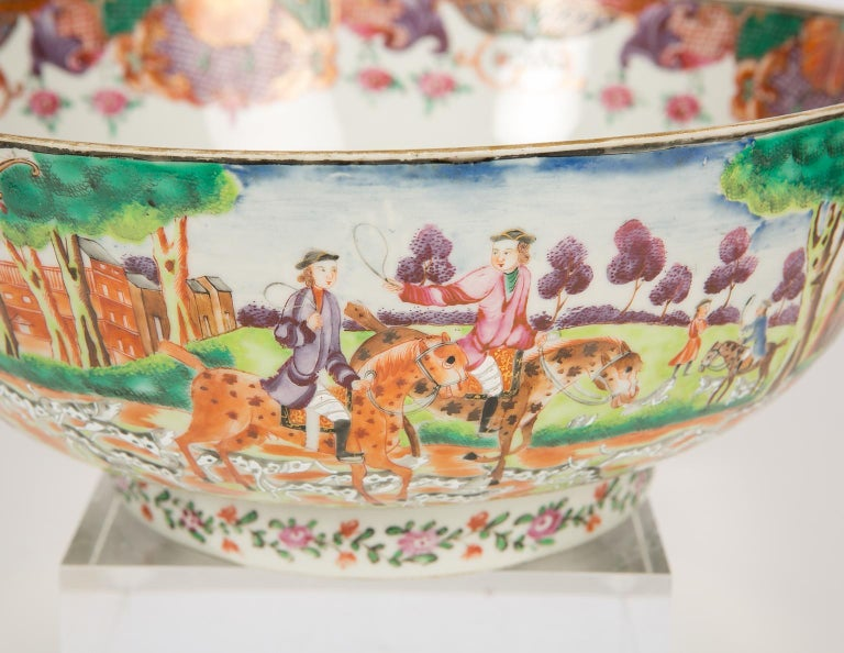 WHY WE LOVE IT: The Horses! the Riders! We are pleased to offer this exquisite Chinese porcelain hunt bowl painted in Famille Rose over-glaze enamels. The strong color palette and rich decoration are hallmarks of Chinese export hunt bowls of the