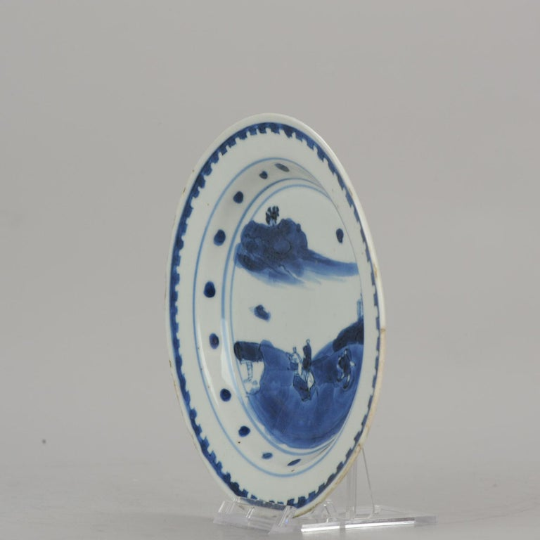 Description  A blue and white late Ming / transitional plate with a nice and rare decoration  15-7-19-1-14   Condition Overall condition good rim fritting. Size: 148mm.  Period 17th century transitional (1620-1661).