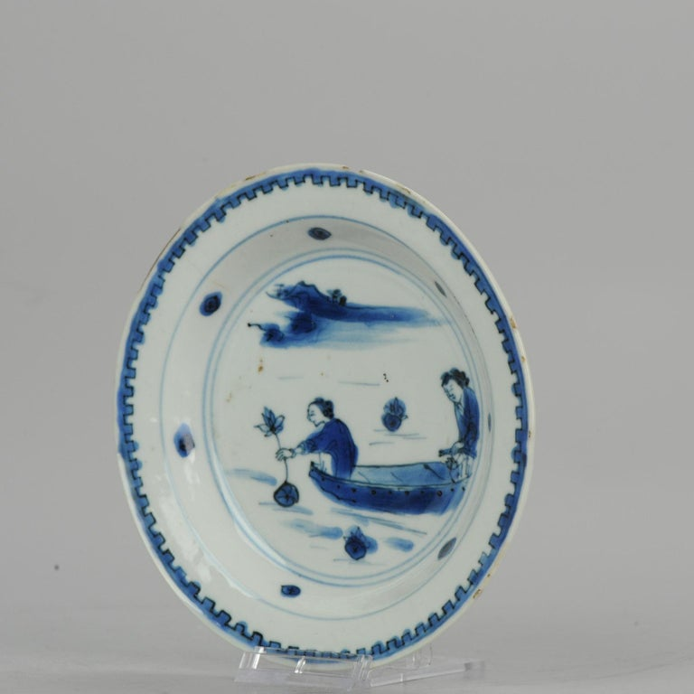 A blue and white late Ming or Transitional plate with a nice and rare decoration  15-7-19-1-14          Condition Overall condition good rimfritting and 1 chip and 1 hairline. Size: 146mm  Period: 17th century Transitional