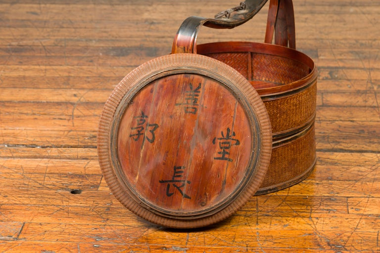 Antique Chinese Rattan Tiered Lunch Box with Carved Handle and Calligraphy For Sale 2
