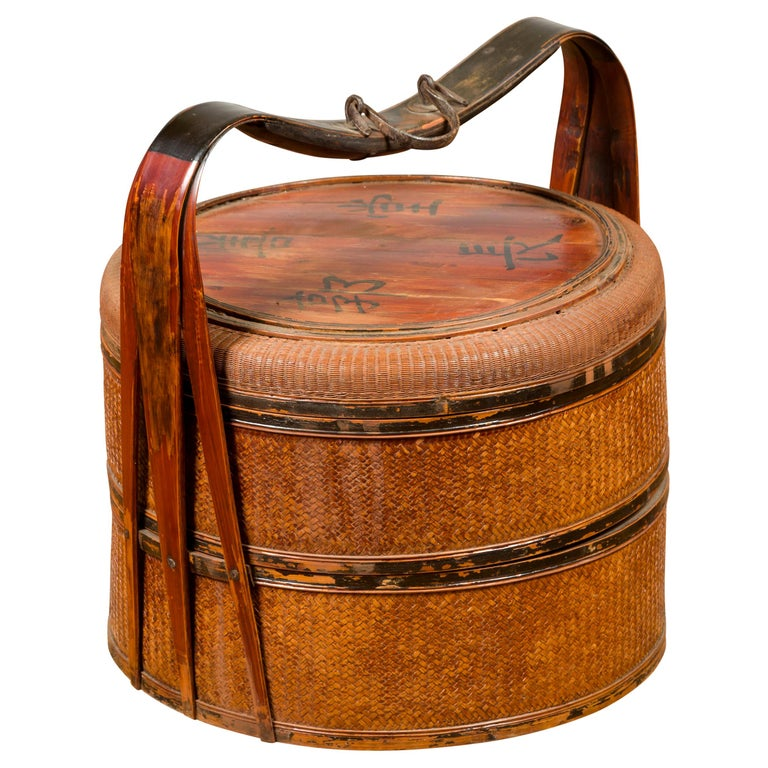 Antique Chinese Rattan Tiered Lunch Box with Carved Handle and Calligraphy For Sale