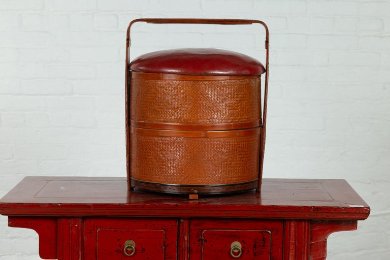 20th Century Antique Chinese Rattan Tiered Wedding Basket with Carved Handle and Red Top For Sale