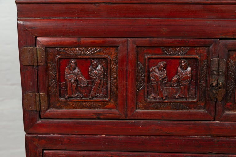 20th Century Antique Chinese Red and Black Lacquered Three-Section Chest with Carved Figures For Sale