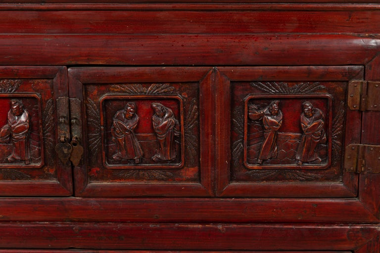 Wood Antique Chinese Red and Black Lacquered Three-Section Chest with Carved Figures For Sale