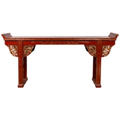 Antique Chinese Red Lacquered Console Table with Gilt Accents and Carved Apron