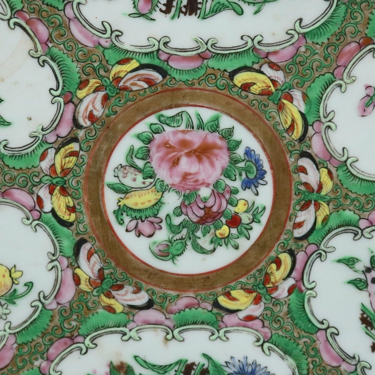 An antique Chinese Rose Medallion enameled porcelain platter offers hand painted panels of garden scenes including flowers and birds (pheasants), gilt highlights throughout, circa 1890  ***DELIVERY NOTICE – Due to COVID-19 we are employing