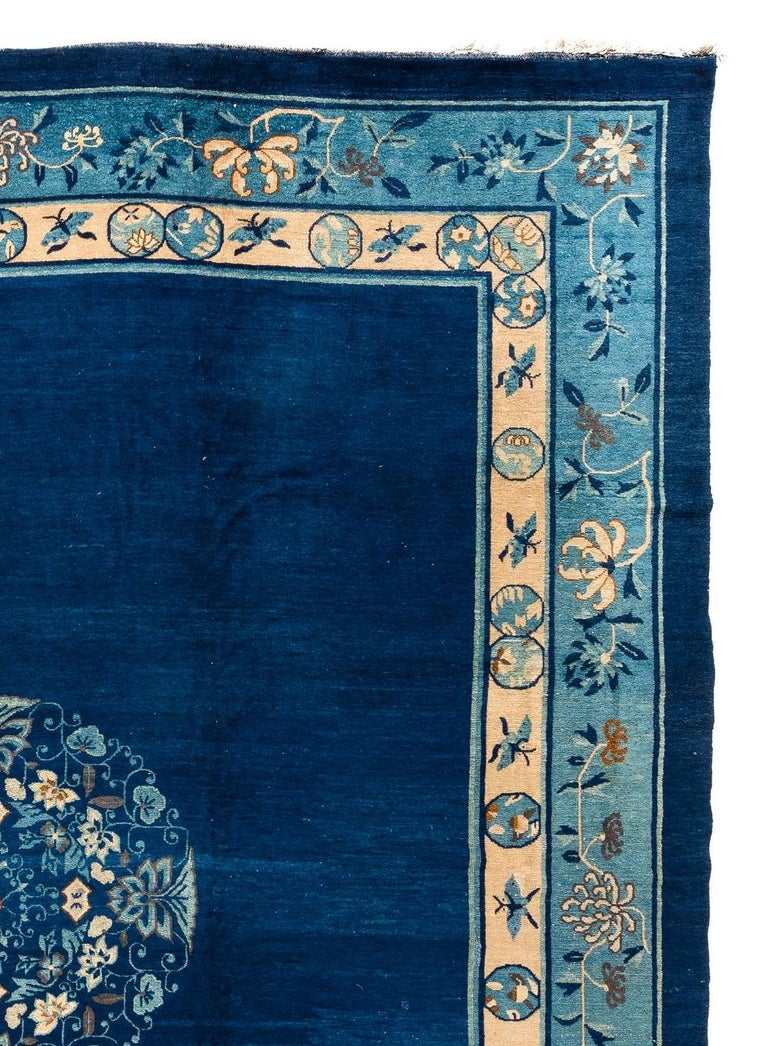 Hand-Knotted Antique Chinese Rug with Plain Blue Field with Patterned Borders and Butterflies For Sale