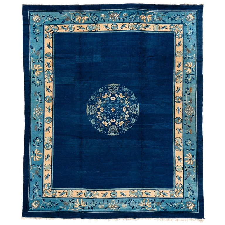 Antique Chinese Rug with Plain Blue Field with Patterned Borders and Butterflies For Sale