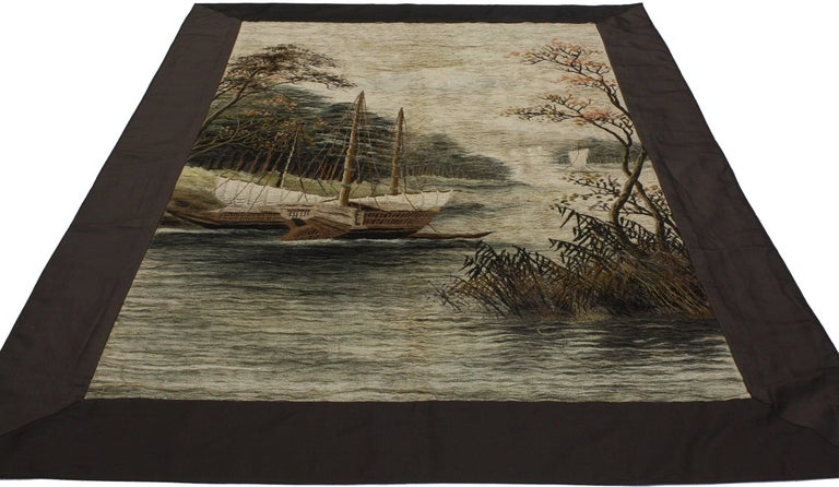71052, antique Chinese silk embroidered tapestry. This handwoven silk antique Chinese embroidered tapestry features a soothing nautical scene. River waters pour gently into the foreground while three small boats are docked along the banks. What