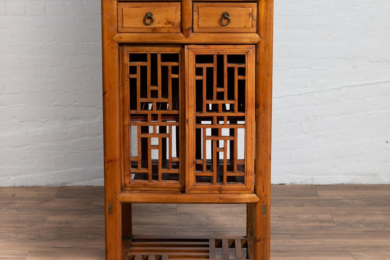 Antique Chinese Slender Kitchen Cabinet With Doors Drawers And Open Fretwork