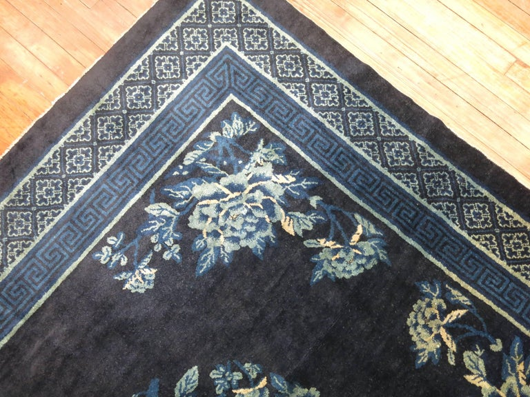 A vintage Chinese square rug in predominant shades of midnight blue. The wool is very soft and all the colors are natural.