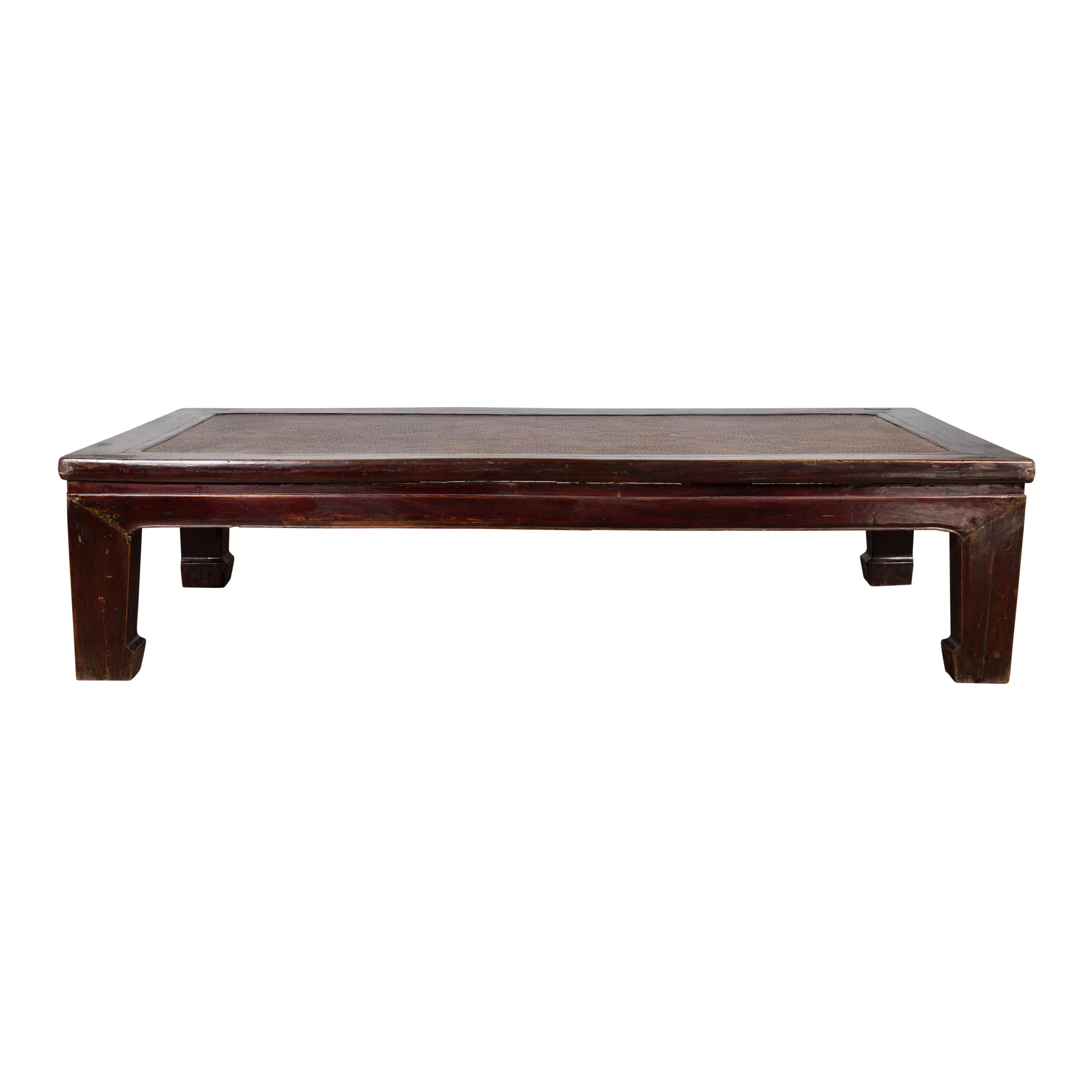 Antique Chinese Wooden Coffee Table with Dark Patina and Woven Rattan Top