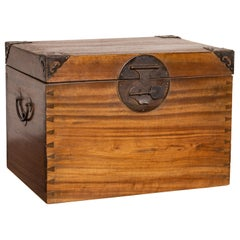Antique Chinese Wooden Treasure Chest with Cutout Metal Braces and Dovetails
