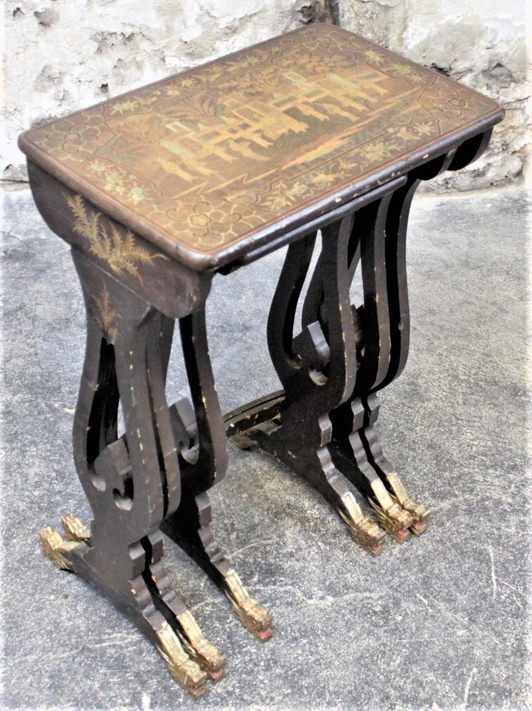 Hand-Carved Antique Chinoiserie Black Lacquered Nesting Table Set with Carved Dragon Feet For Sale
