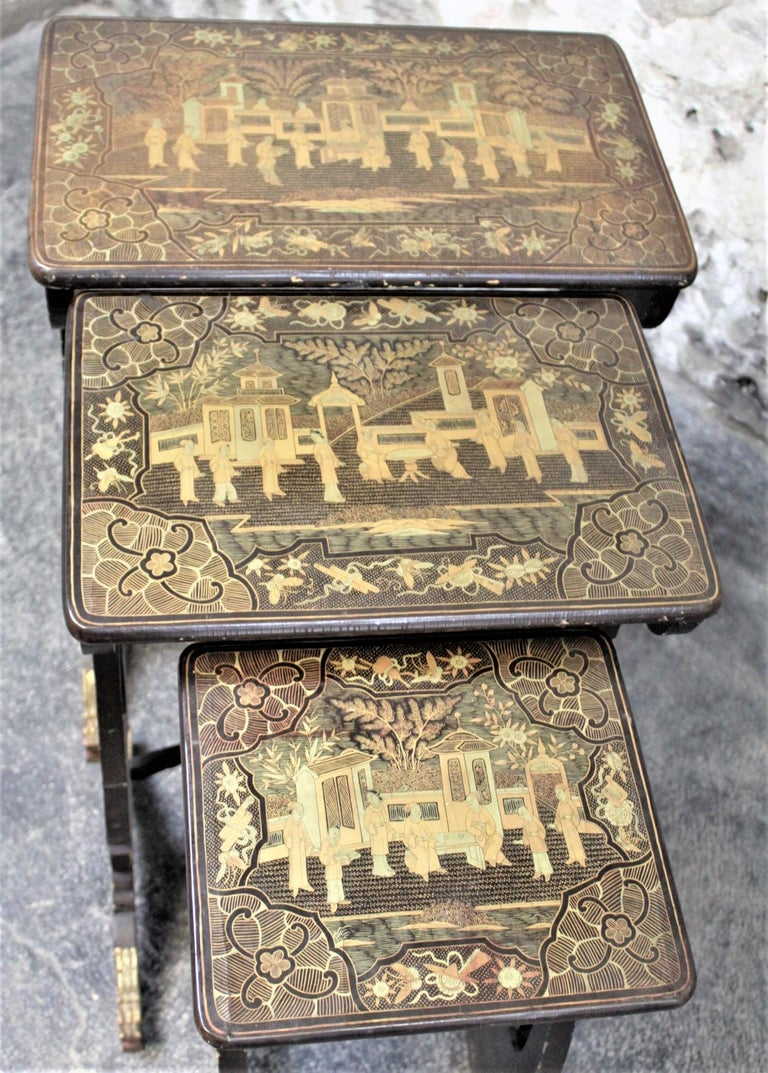 Antique Chinoiserie Black Lacquered Nesting Table Set with Carved Dragon Feet For Sale 1
