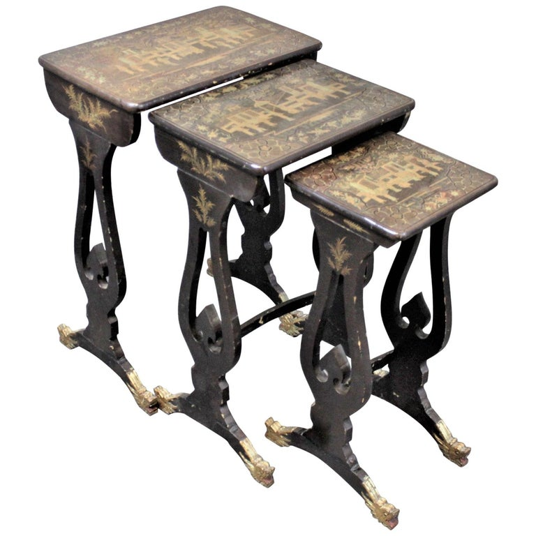 Antique Chinoiserie Black Lacquered Nesting Table Set with Carved Dragon Feet For Sale
