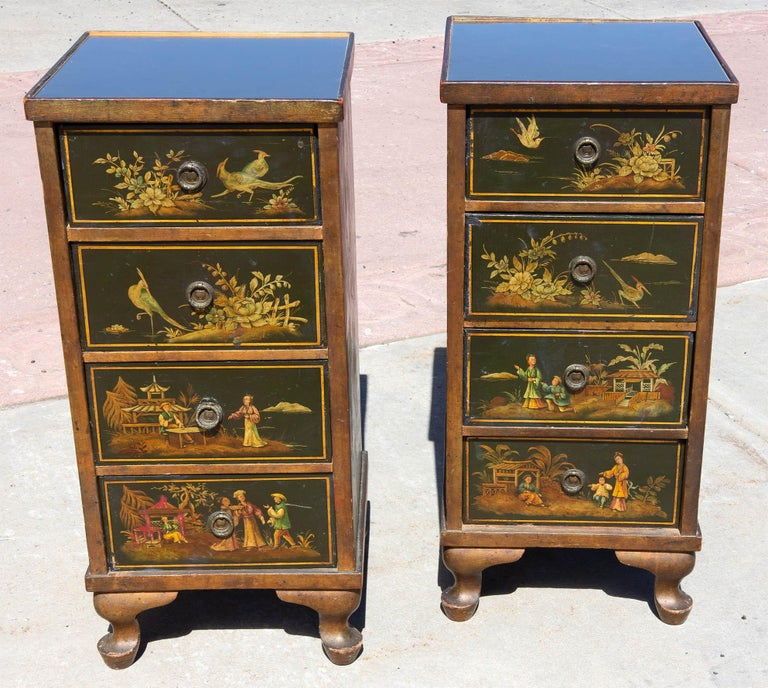 19th century chinoiserie four-drawer side cabinets. Beautiful hand painted chinoiserie on three sides. Reverse painted glass tops in muted antique gold. English. Measures: 29.5
