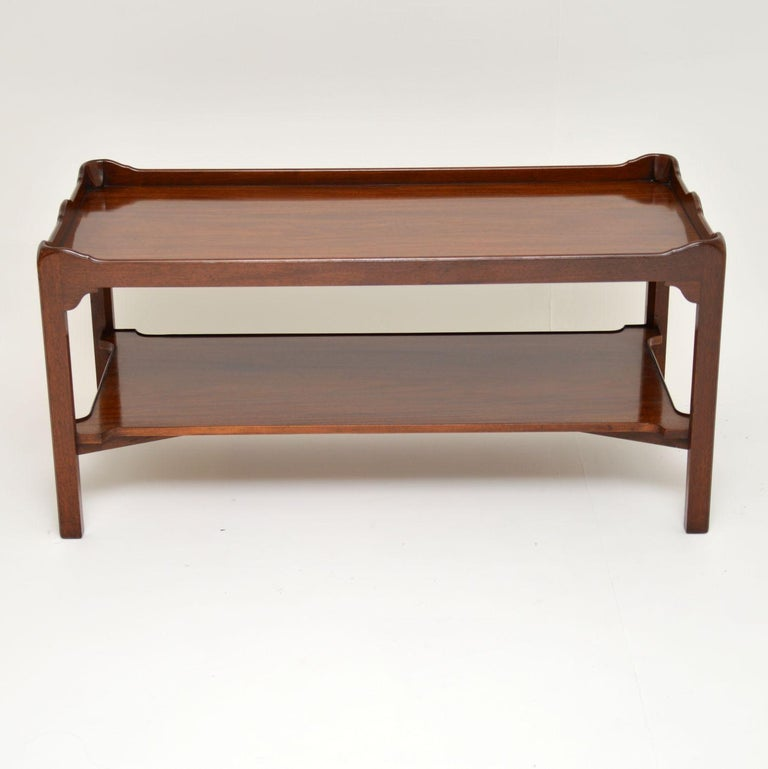 Antique mahogany tray top Chippendale style coffee table, dating to circa 1930s period and in excellent condition.  This table is of good quality & is also very practicable. It has a fixed tray top with a shaped gallery & a useful lower level