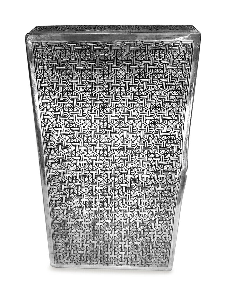 Antique  cigarette box in rectangle shape . This unique box is all hand carved and  the design is absolutely fantastic  . The design is like woven lines .the box is Persian silver 0.84 proof .  Designer : Aghazadeh .tehran weight :285 grams W : 3' L