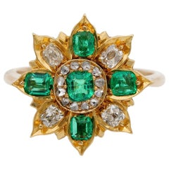 Antique circa 1900 .75 Carat Colombian Emerald .80 Carat Diamond Flower Ring