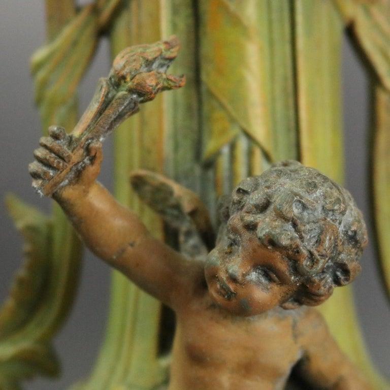 Cast Antique Classical Greek Verdigris Metal and Marble Figural Cherub Urns For Sale