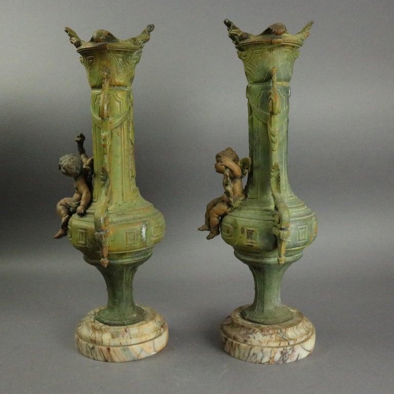 20th Century Antique Classical Greek Verdigris Metal and Marble Figural Cherub Urns For Sale