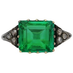 Antique Colombian Emerald and Diamond Flanked Solitaire Ring, circa 1860