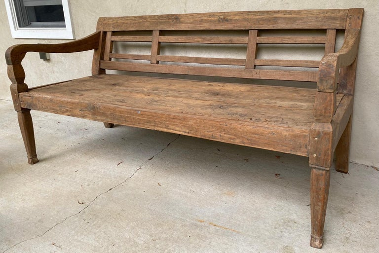 This bench is made of solid teak wood and generally comes from farms developed by Dutch settlers in the early 20th century. Size of this bench allows above average size people to seat comfortably or used to recline for afternoon rest and relaxation.