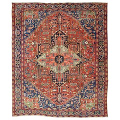 Antique Colorful Persian Heriz-Serapi rug with a Bold Geometric Design