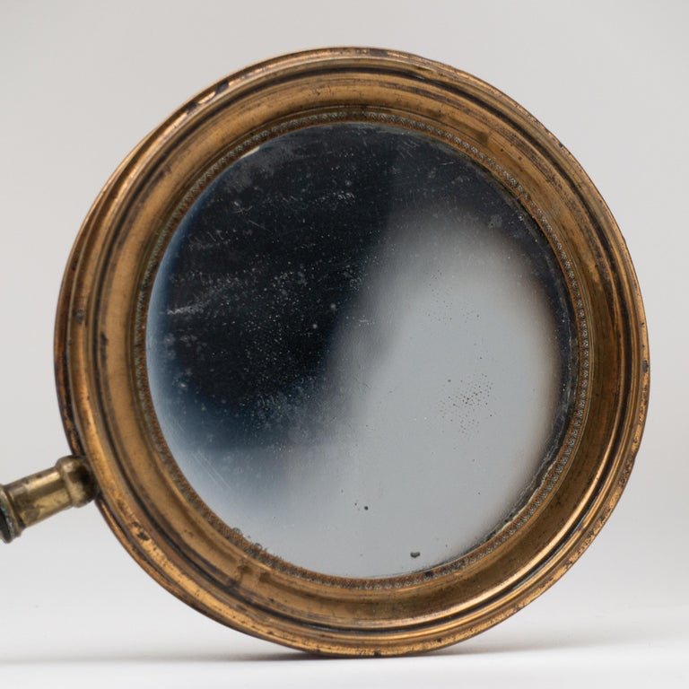 English Antique Concave Brass and Carved Wood Hand Mirror, 19th Century For Sale