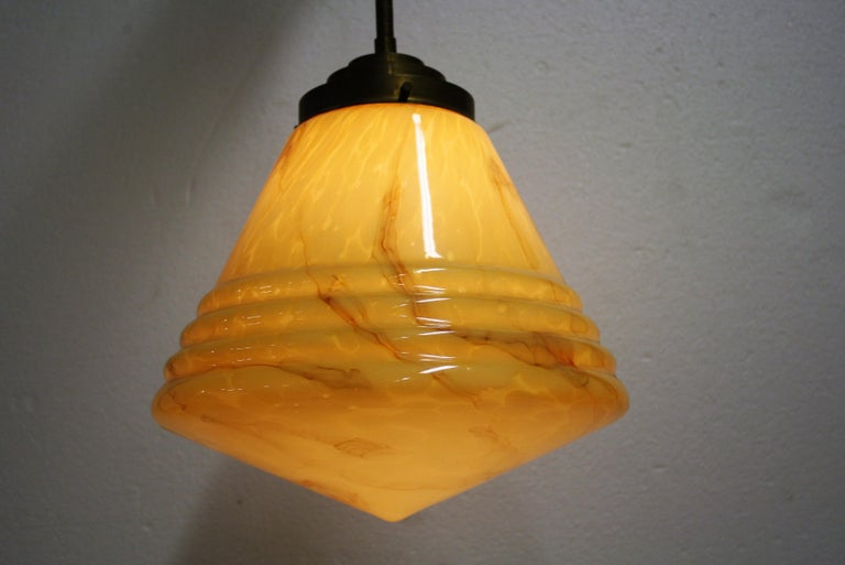 Antique conical shaped marbled glass pendant light.