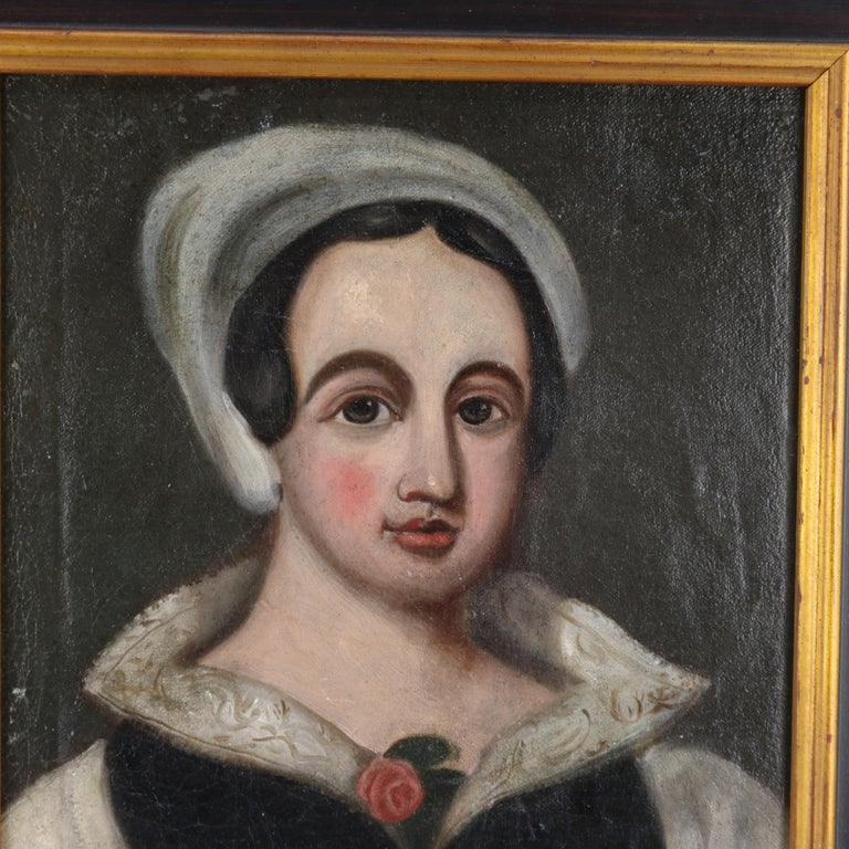 An antique Continental portrait painting is oil on canvas laid on board and depicts young woman, unsigned and giltwood framed, 19th century  Measures: 18