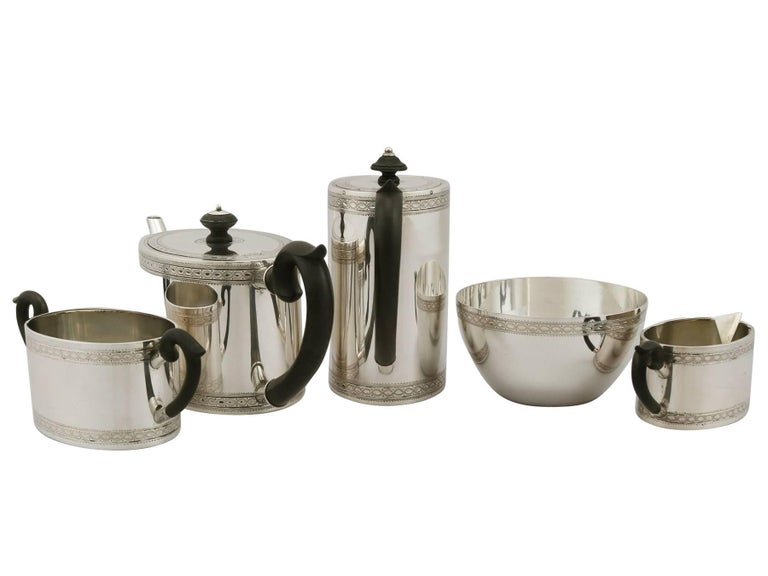 An exceptional, fine and impressive antique European sterling silver five-piece tea and coffee set/service; part of our silver teaware collection.  This exceptional antique European silver tea and coffee set consists of a coffee pot, teapot, cream