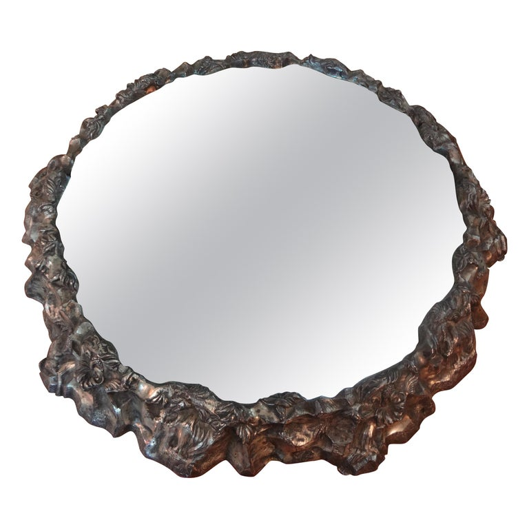 Stunning antique continental silver plated plateau with mirrored top. This unusual round silver plate plateau can be used as a centerpiece, serveware or to display a most prized possession. Our silver plate plateau dates from 1900-1910.